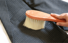 a suit and a brush