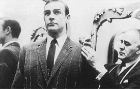 tailor taking suit measurement