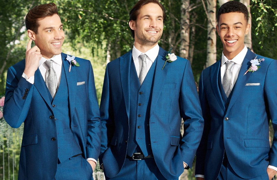 three men in blue wedding suits