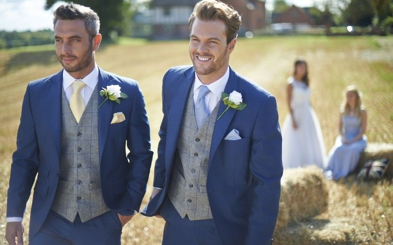 two men in a wedding suits